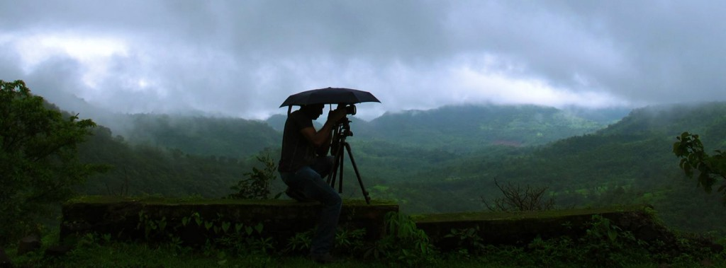 Use an umbrella to shoot during he monsoons